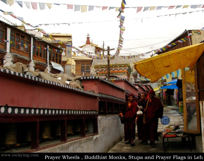 Prayer Wheels, Buddhist Monks, Stupa and Prayer Flags in Leh